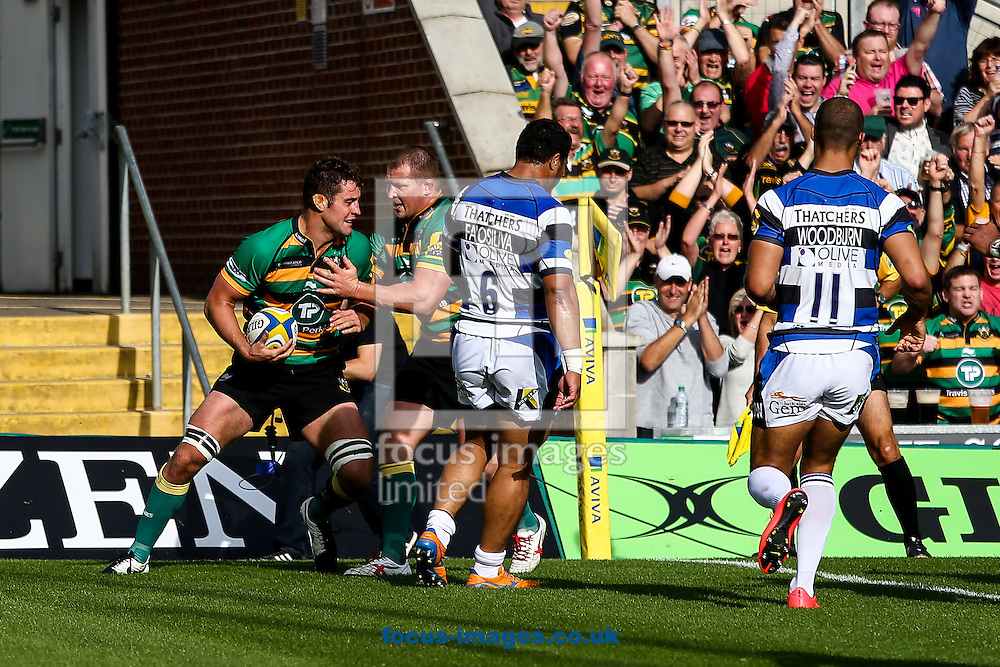 Calum Clark of Northampton Saints (left) celebrates his try during the Aviva Premiership match at Franklin's Gardens, Northampton<br /> Picture by Andy Kearns/Focus Images Ltd 0781 864 4264<br /> 27/09/2014