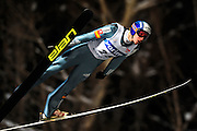 Robert Kranjec of Slovenia soars through the night during the FIS World Cup Ski Jumping in Sapporo, northern Japan in February, 2008.