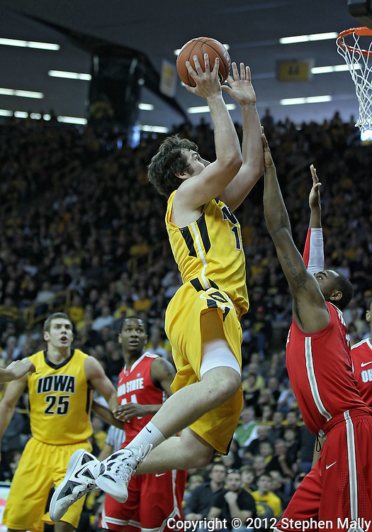 January 07, 2011: Iowa Hawkeyes forward Zach McCabe (15) drives on Ohio State Buckeyes forward Deshaun Thomas (1) during the the NCAA basketball game between the Ohio State Buckeyes and the Iowa Hawkeyes at Carver-Hawkeye Arena in Iowa City, Iowa on Saturday, January 7, 2012.