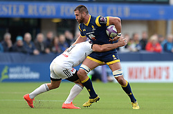 Zac Xiourouppa of Worcester Warriors is challenged by Arnaud Mignardi of Brive - Mandatory by-line: Dougie Allward/JMP - 22/10/2016 - RUGBY - Sixways Stadium - Worcester, England - Worcester Warriors v Brive - European Challenge Cup