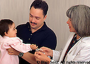 Medical, Physician at Work, Hispanic Father and Infant, Caucasian Pediatrician, Urban Clinic