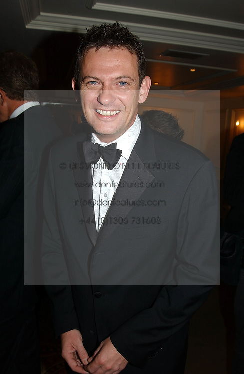 TV gossip writer MATTHEW WRIGHT at The Caron Keating Foundation Dinner in honour of the late TV presenter who died in April 2004, held at The Savoy, London on 4th October 2004.<br />