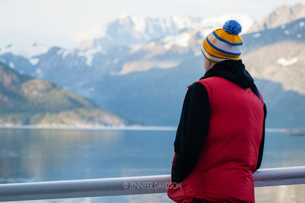 A guest onboard the National Geographic Sea Lion looks out on the scenery of Glacier Bay National Park, Alaska.