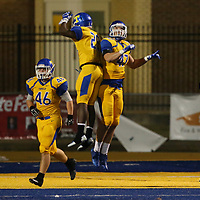 Tupelo's Peter Gray celebrates a pick-six with teammate Jake Morris during Friday night's game against Oxford.