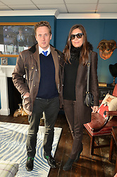 HARRY BECHER and AMANDA FERRY at the 2014 Hennessy Gold Cup at Newbury Racecourse, Newbury, Berkshire on 29th November 2014.  The Gold Cup was won by Many Clouds ridden by Leighton Aspell,