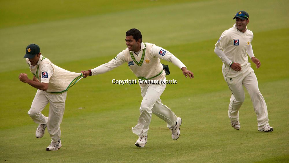 Yasir Hameed is grabbed by Umar Akmal after catching Jonathan Trott during the third npower Test Match between England and Pakistan at the Oval.  Photo: Graham Morris (Tel: +44(0)20 8969 4192 Email: sales@cricketpix.com) 18/08/10