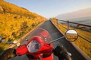 Motorscooter traveling through autumn-colored vines in the Lavaux Wine Country, along Lake Geneva, near Lausanne, Switzerland. The Lavaux Wine Country was named as a UNESCO World Heritage Site in 2007. http://www.gettyimages.com/detail/photo/motor-scooter-riding-through-vineyards-high-res-stock-photography/83107779