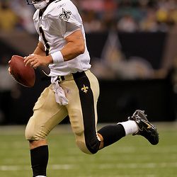 2009 September 03: New Orleans Saints quarterback Joey Harrington (3) runs with the ball during the first half of a preseason game between the Miami Dolphins and the New Orleans Saints at the Louisiana Superdome in New Orleans, Louisiana.