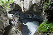 The powerful Trümmelbach Falls are a popular series of ten waterfalls in a slot canyon made accessible by lifts, tunnels, paths and artificial lights (run commercially) in Lauterbrunnen Valley, Bern canton, Switzerland, the Alps, Europe. Trümmelbachfälle drains the mighty glaciers of Eiger (3970 m), Mönch (4099 m) and Jungfrau (4158 m). To avoid crowds, go at opening time in the morning and bring rain gear.