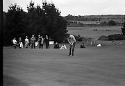 Christy O'Connor putting at the Irish Dunlop £1,000 Tournament at Tramore Golf Club, Co. Waterford on the 19th August 1967.
