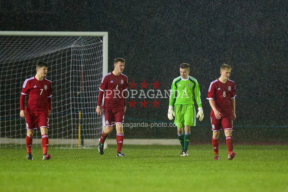 CONNAH'S QUAY, WALES - Thursday, March 20, 2014: Wales' Liam Cullen, Daniel Jefferies, goalkeeper Scott Coughlin and Matty Smith look dejected as Poland score the only goal of the game during the Under-15's International Friendly match at the Deeside Stadium. (Pic by David Rawcliffe/Propaganda)