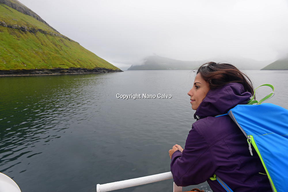 Young woman travels on Sam, ferry from Klaksvík to Syðradalur (Kalsoy)