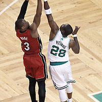 07 June 2012: Miami Heat shooting guard Dwyane Wade (3) takes a jumpshot over Boston Celtics small forward Mickael Pietrus (28) during first half of Game 6 of the Eastern Conference Finals playoff series, Heat at Celtics at the TD Banknorth Garden, Boston, Massachusetts, USA.
