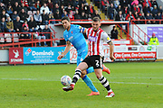 Pierce Sweeney (2) of Exeter City shoots at goal during the EFL Sky Bet League 2 match between Exeter City and Cheltenham Town at St James' Park, Exeter, England on 16 November 2019.
