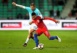 Jesse Lingard of England holds off Valter Birsa of Slovenia - Mandatory by-line: Robbie Stephenson/JMP - 11/10/2016 - FOOTBALL - RSC Stozice - Ljubljana, England - Slovenia v England - World Cup European Qualifier