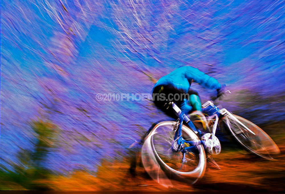 CYCLING - blurred action of a speedy fast uphill leisure mountain biker SPORT