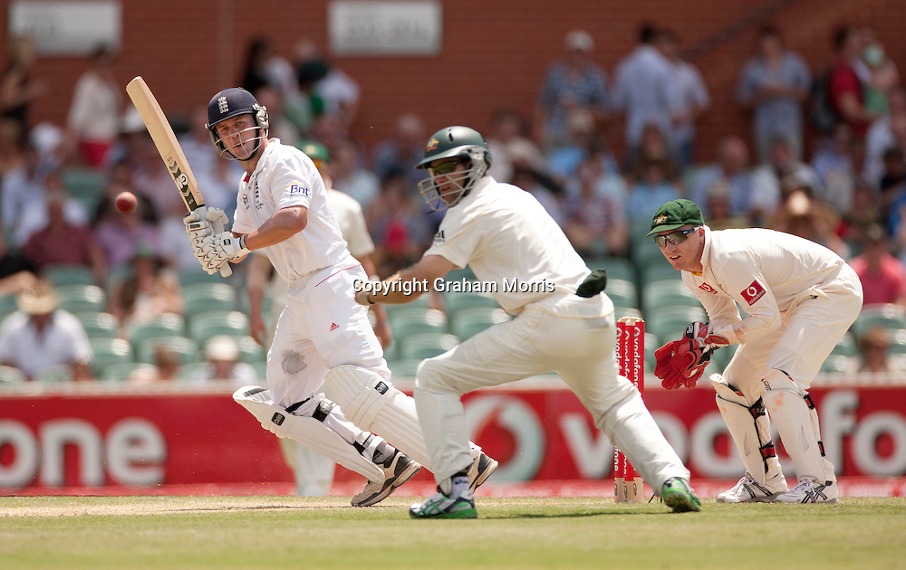 Jonathan Trott off Xavier Doherty past close fielder Simon Katich during the second Ashes Test Match between Australia and England at the Adelaide Oval. Photo: Graham Morris (Tel: +44(0)20 8969 4192 Email: sales@cricketpix.com) 4/12/10