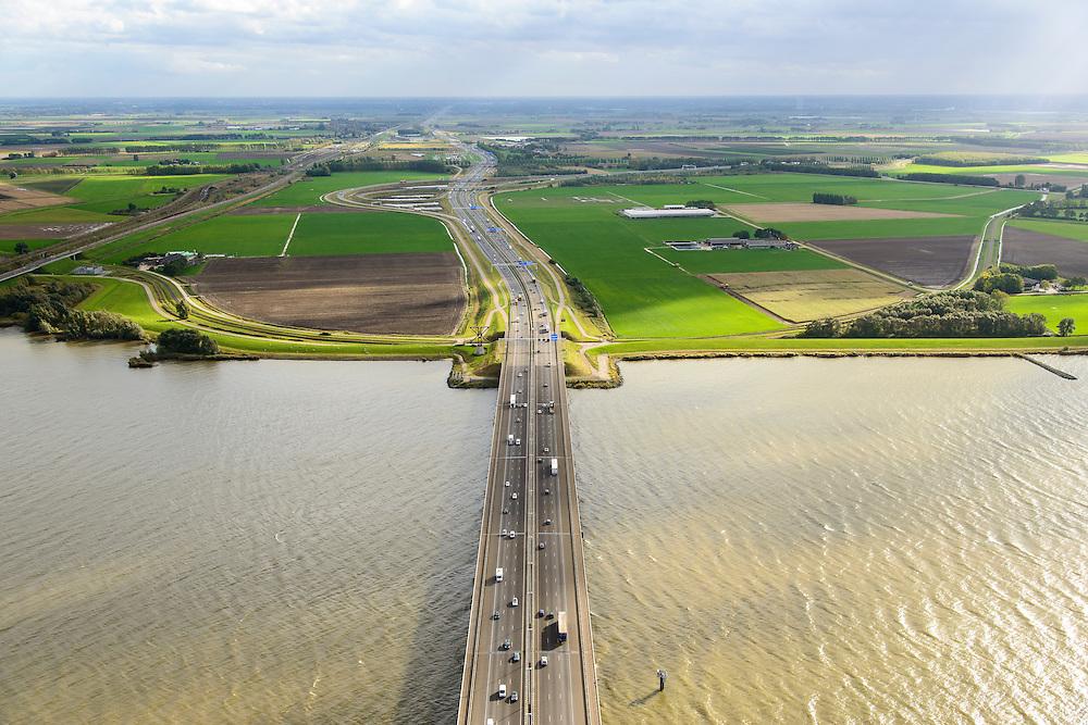 Nederland, Zuid-Holland, Hollandsch Diep, 23-10-2013; <br /> Brug van de A16 over het Hollandsch Diep in de richting van Knooppunt Klaverpolder. <br /> Road bridge (A16) on the  Hollandsch Diep.<br /> luchtfoto (toeslag op standaard tarieven);<br /> aerial photo (additional fee required);<br /> copyright foto/photo Siebe Swart.