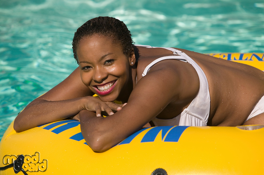 Woman Relaxing on Pool Float