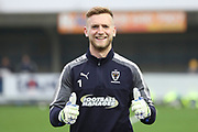 AFC Wimbledon goalkeeper George Long (1) warming up during the EFL Sky Bet League 1 match between AFC Wimbledon and Charlton Athletic at the Cherry Red Records Stadium, Kingston, England on 10 April 2018. Picture by Matthew Redman.
