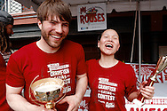 "Photograph of Sonya ""The Black Widow"" Thomas congratulates Adrian ""The Rabbit"" Morgan as he takes first place at the Rouses Markets 2014 World Crawfish Eating Contest at French Quarter Fest in New Orleans, LA."