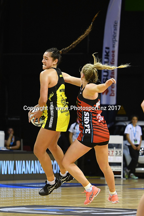 Pulse's Tiana Metuarau (L) takes a pass with Tactix's Zoe Walker during the ANZ Premiership netball match between the Wellington Pulse vs Mainland Tactix at TSB Arena in Wellington on Sunday the 9th of April 2017. Copyright Photo by Marty Melville / www.Photosport.nz
