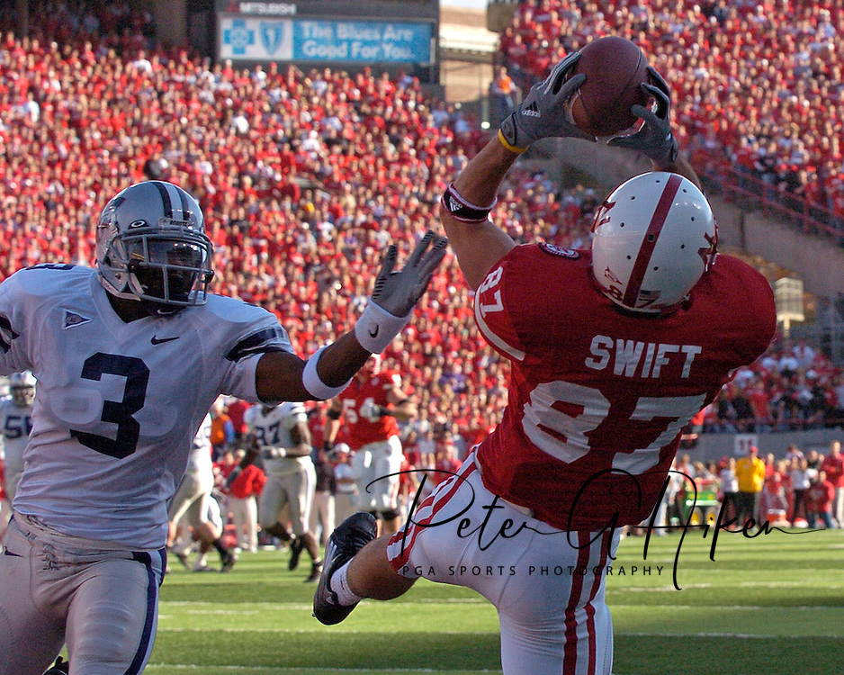 Nebraska wide receiver Nate Swift (R) pulls in a 19-yard touchdown pass late in the second quarter, as Kansas State defensive back Bryan Baldwin (L) defends on the play.  Nebraska defeated Kansas State 27-25 at Memorial Stadium in Lincoln, Nebraska, November 12, 2005.