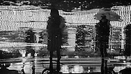 France. Paris. 4th district..  pedestrians shadows and reflection on Rivoli street under the rain at night