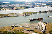 Nederland, Zuid-Holland, Nieuwe Waterweg, 04-07-2006;  Maeslantkering in de Nieuwe Waterweg, de waterkering sluit bij een waterstand van 3 meter of meer boven NAP; de kering, onderdeevan de Deltawerken,   beschermt Rotterdam en achterland bij extreme waterstanden. achter de kering het Calandkanaamet daarachter 4e Petroleumhaven met tanks voor olieopslag..Netherlands, Hoek van Holland / Rotterdam harbour, 2006. Aeriaview of the new storm surge barrier (Maeslantkering) in the Nieuwe waterweg, leading to the harbours. Two enormous doors wilclose of this river for high seas. Northsea is to the right. .luchtfoto (toeslag); aerial photo (additional fee required); .foto Siebe Swart / photo Siebe Swart