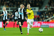 Miguel Almiron (#24) of Newcastle United and Mark Sykes (#18) of Oxford United battle for the ball during the The FA Cup match between Newcastle United and Oxford United at St. James's Park, Newcastle, England on 25 January 2020.
