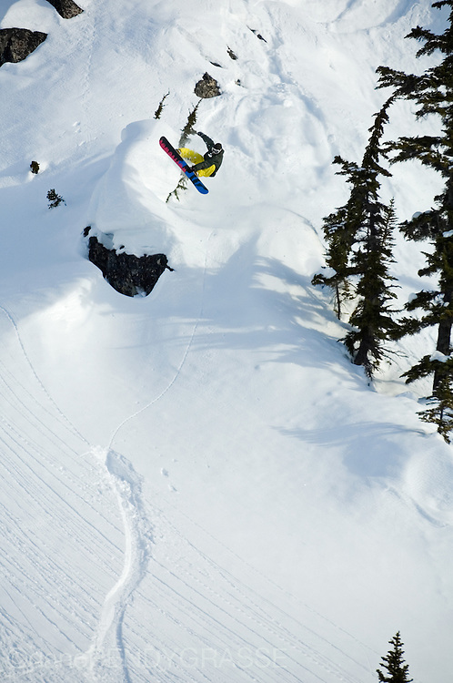 Snowboarder Mathieu Crepel airs into a snowy face in British Columbia, Canada.