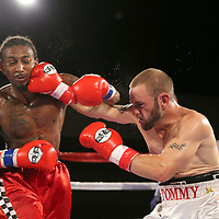 Leonardo Kenon fights Tommy Bryant during a Fire Fist Boxing Promotions boxing match at the A La Carte Pavilion on Saturday, August 12 , 2017 in Tampa, Florida.  (Alex Menendez via AP)