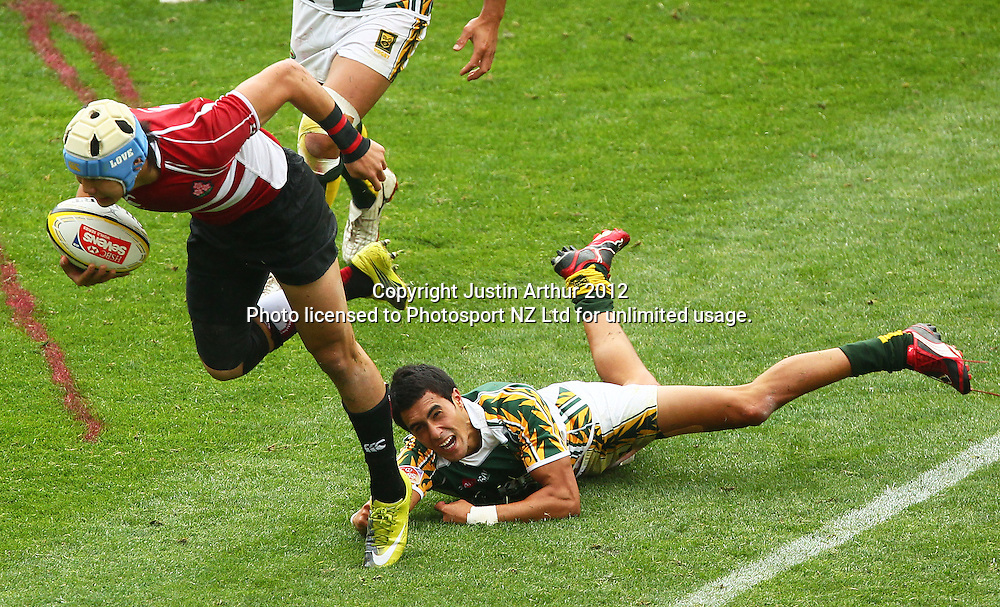 Tiakina Manga fails to tackle Japan's Yoshikazu Fujitia. Hertz Wellington Sevens - Day two at Westpac Stadium, Wellington, New Zealand on Saturday, 4 February 2012. Photo: Justin Arthur / photosport.co.nz
