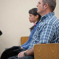 Former followers of the religious sect Aggressive Christianity Hannah Jordan, front row far, and his son Joshua Green, front row near,  listen to the testimony of James Green during his sentencing hearing at the 13th Judicial District Courthouse in Grants on Friday.