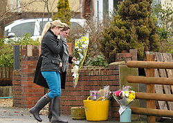 © Licensed to London News Pictures. 28/01/2013. Bristol, UK. Flowers are left at the scene where two cyclists, husband and wife Ross and Clare Simons, died after they were involved in a hit and run accident yesterday (27 January) with a vehicle in Lower Hanham Road, Hanham, Bristol.  The police have said they tried to flag the vehicle down before the accident because it was going at speed.  28 January 2013..Photo credit : Simon Chapman/LNP