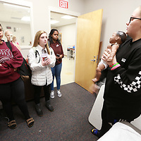 Lillian Allen, 17, right, shows one of the training dolls used in the Health Sciences course for students who want to pursue a career in the health field.