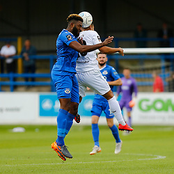 Eastleighs defender Réda Johnson wins the ball in the air over Dovers forward Jamie Allen during the National League match between Dover Athletic FC and Eastleigh FC at Crabble Stadium, Kent on 25 August 2018. Photo by Matt Bristow.