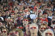 Ole Miss football fan Sam Woodward, dressed as former Chicago Bears coach Mike Ditka, watches a 3D 90 second clip during halftime against Auburn at Vaught-Hemingway Stadium in Oxford, Miss. on Saturday, October 30, 2010. Auburn won 51-31.