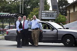 August 13, 2017 - Chicago, IL, USA - Chicago Police officers investigate the scene of a double homicide on the steps of Friendship Baptist Church, located in the 200 block of South Laramie, on Sunday, Aug. 13, 2017, in Chicago's Austin community. According to witnesses at the scene, the two men were gunned down as they were preparing to attend a service Sunday afternoon. (Credit Image: © Alyssa Pointer/TNS via ZUMA Wire)