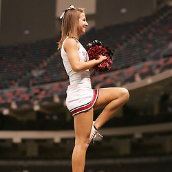 21 December 2008:  A Troy cheerleader performs during a 30-27 overtime victory by the Southern Mississippi Golden Eagles over the Troy Trojans in the  R+L Carriers New Orleans Bowl at the New Orleans Superdome in New Orleans, LA.