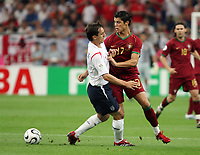 Photo: Chris Ratcliffe.<br /> England v Portugal. Quarter Finals, FIFA World Cup 2006. 01/07/2006.<br /> Gary Neville of England clashes with Ronaldo of Portugal.