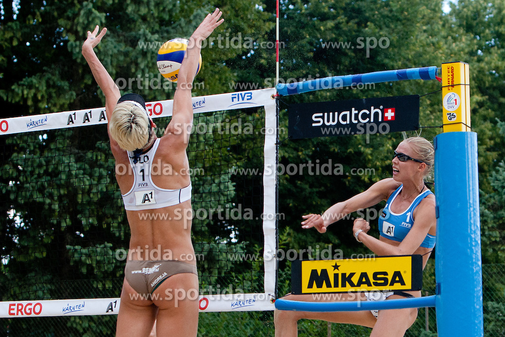 Andreja Vodeb of Slovenia blocks Anastasia Vasina of Russia shot for victory and qualification to main draw at A1 Beach Volleyball Grand Slam presented by ERGO tournament of Swatch FIVB World Tour 2012, on July 17, 2012 in Klagenfurt, Austria. (Photo by Matic Klansek Velej / Sportida)