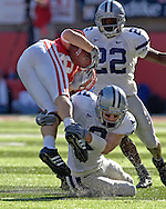 Kansas State free safety Marcus Watts (2) makes a tackle on Nebraska wide receiver Nate Swift (L) in the first quarter.  Nebraska defeated Kansas State 27-25 at Memorial Stadium in Lincoln, Nebraska, November 12, 2005.
