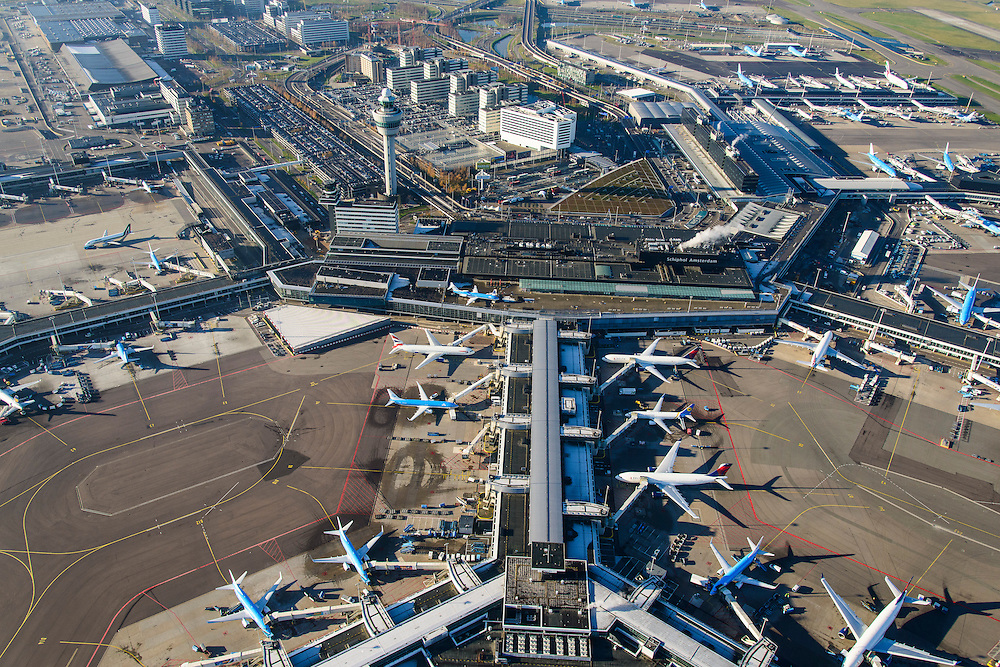 Nederland, Noord-Holland, Haarlemmermeer, 11-12-2013; luchthaven Schiphol. Stationsgebouw en aan de gates geparkeerde vliegtuigen van onder andere KLM.<br /> Schiphol Airport. Terminal building and control tower surrounded by hotels and office buildings operated by Schiphol Real Estate (SRE). At the gates of parked aircraft, amongst others KLM.<br /> luchtfoto (toeslag op standard tarieven);<br /> aerial photo (additional fee required);<br /> copyright foto/photo Siebe Swart