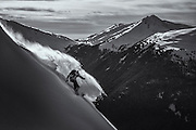 Suz Graham slashes along a windlip in the Whistler backcountry.