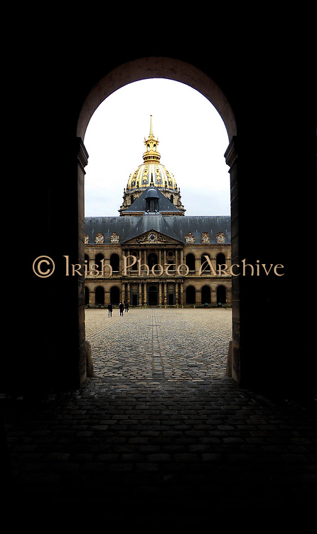 Cobbled road leading into Les Invallides a complex of buildings in the 7th arrondissement of Paris, France, containing museums and monuments, relating to the military history of France. The Basilica that houses the sarcophagus of Napoleon I