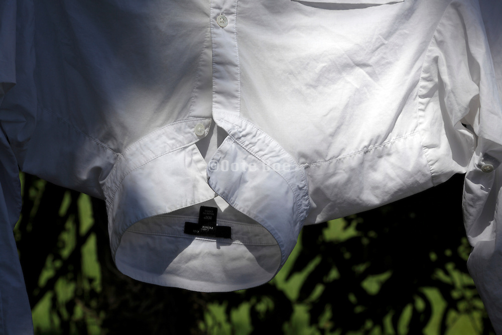 white shirt hanging to dry
