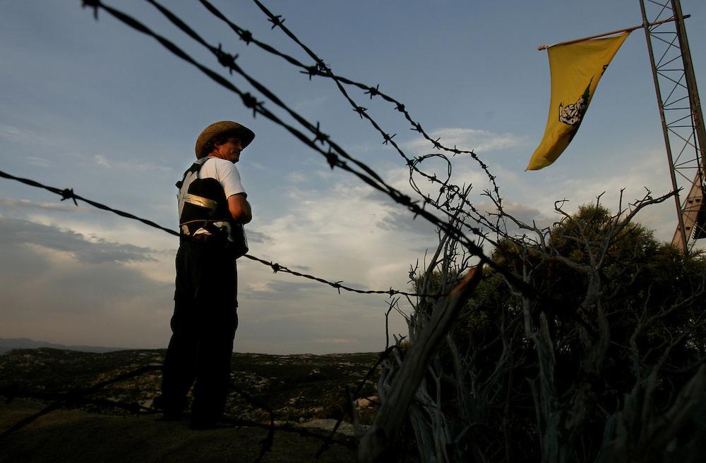 A California Minutemeen volunteer patrols the border in Campo, CA.