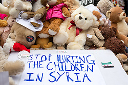 © Licensed to London News Pictures. 22/10/2016. London, UK. Teddies pictured next to a demonstration placard at the 'Rally For Aleppo', calling for the government to do more to stop the bombing in Syria. Photo credit : Tom Nicholson/LNP
