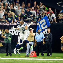 Oct 30, 2016; New Orleans, LA, USA; Seattle Seahawks free safety Earl Thomas (29) and wide receiver Doug Baldwin (89) celebrate after a defensive touchdown against the New Orleans Saints during the first quarter of a game at the Mercedes-Benz Superdome. Mandatory Credit: Derick E. Hingle-USA TODAY Sports